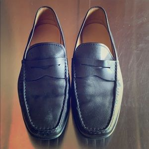 Men's black loafers.